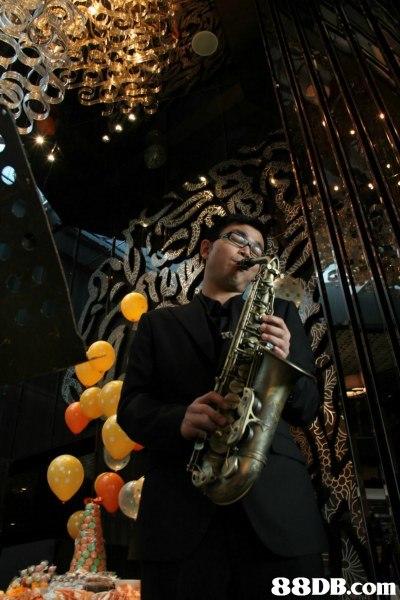 saxophone,music,musician,musical instrument,woodwind instrument